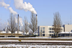 Office and oil refinery in winter landscape Stock Photos