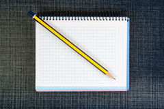 Office pad-notebook and a pencil. Royalty Free Stock Photo
