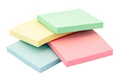 Office paper. Stacks of colorful office adhesive paper Stock Photos