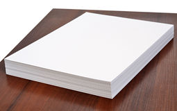 Office paper. Stack of office paper isolated on wooden table Stock Image