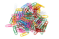Office paper clips. Pile of multiple colorful office paper clips, isolated over the white background Royalty Free Stock Image