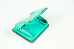 Office paper hole puncher. Green hole-puncher isolated on white Stock Photo