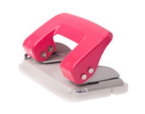 Office paper hole puncher on background Royalty Free Stock Photos