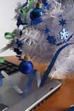 Office party. Laptop  and white cristmas tree Stock Photo