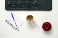 Office : PC keyboard, notebook, apple and coffee cup Royalty Free Stock Photo