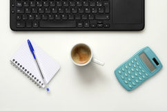 Office : PC keyboard, notebook, calculator and coffee cup Stock Image