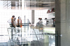 Office People. People behind glass in an office. Motion blur Royalty Free Stock Image