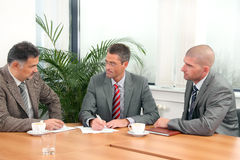 Office people - men. Three businessmen during the meeting Stock Photography