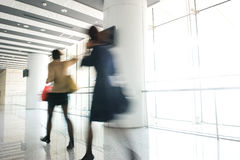 Office people in motion blur Royalty Free Stock Image