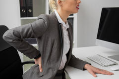 Office person having back pain Royalty Free Stock Photo