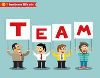 Office personnel holding team sign Royalty Free Stock Image