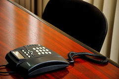 Office phone. Office desk with close-up on the phone Stock Photos
