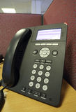Office Phone. A phone on a desk in an office Stock Photos