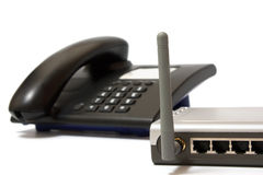 Office phone and wi-fi router Stock Photo