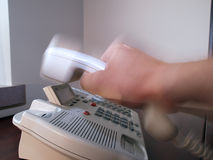 Office phone5. Motion blur of hand picking up or slamming down phone reciever Stock Photo