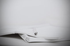 Office. Piles of paperwork. Black and white photo. Shallow depth of field Stock Images