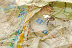 Office pin inserted in the jammed map Royalty Free Stock Photography