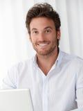 Office portrait of happy businessman Stock Photos