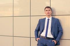 Office portrait of smiling young businessman. It blue suit Stock Images