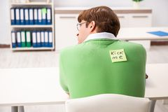The office prank with kick me message on sticky note royalty free stock images