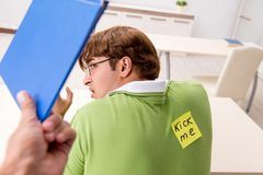 The office prank with kick me message on sticky note. Office prank with kick me message on sticky note royalty free stock images