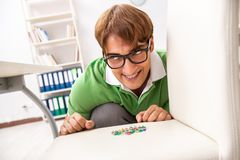 The office prank with sharp thumbtacks on chair stock photography