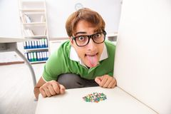 The office prank with sharp thumbtacks on chair. Office prank with sharp thumbtacks on chair royalty free stock photos