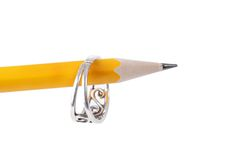 Office proposal. Silver ring hanging on a pencil Stock Photo
