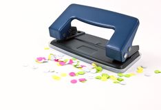 Office puncher with confetti Stock Photo
