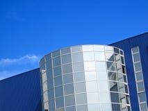 Office realestate modern building on blue sky,. Blue color office realestate modern building with many glass reflective windows on blue sky. modern business stock image