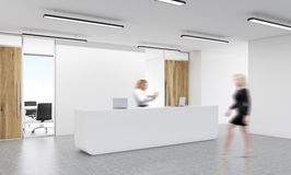 Office reception with businesswomen. Office reception with two blurry businesswomen. 3D Rendering Stock Photo
