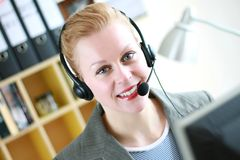 Office receptionist 1. Image taken of a Female receptionist with headphones Royalty Free Stock Photography