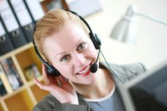 Office receptionist 6. Image taken of a Female receptionist with headphones Royalty Free Stock Image