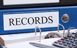 Office records and calculator Stock Image