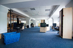 Office relocation. Open-office space undergoing relocation Stock Images