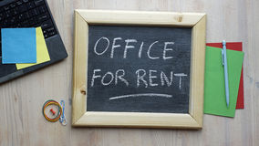 Office for rent. Written on a chalkboard in a office Stock Images