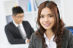 Office of representative. Pretty customer support representative with a pleasant smile working from office royalty free stock photography