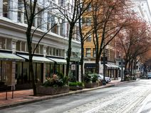 Retail shopping spaces on a tree lined street in downtown Portland, Oregon. royalty free stock photography