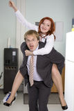 Office ride. Secretary rides his boss Royalty Free Stock Image