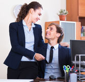 Office romance between clerks at work Stock Image