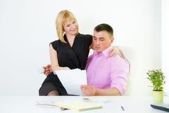 Office romance flirt with boss and secretary. Office flirt with boss and secretary Royalty Free Stock Photography