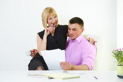 Office romance flirt with boss and secretary. Office flirt with boss and secretary Royalty Free Stock Images