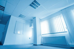 Office room in blue tone Royalty Free Stock Image