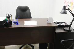 Office room with chair, table, lamp and stationery on it Royalty Free Stock Photography