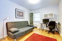 Office room with a couch Royalty Free Stock Photo
