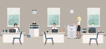 Office room in a gray color. Young women and man are emploees at work Stock Image