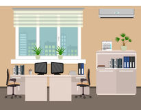 Office room interior including two work spaces with cityscape outside window. Stock Photos