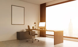 Office room with large window and poster on wall Stock Photo