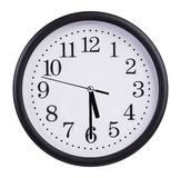 Office round clock shows half past five Royalty Free Stock Images