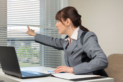 The office routine. The image of business woman in an office Stock Image